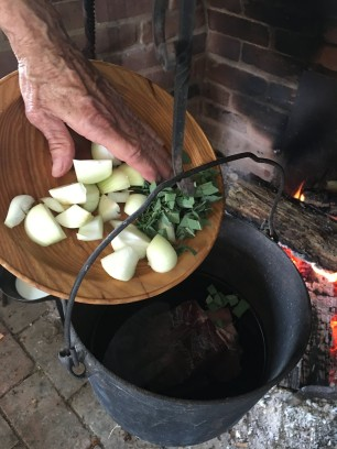 Add onions and herbs to kettle